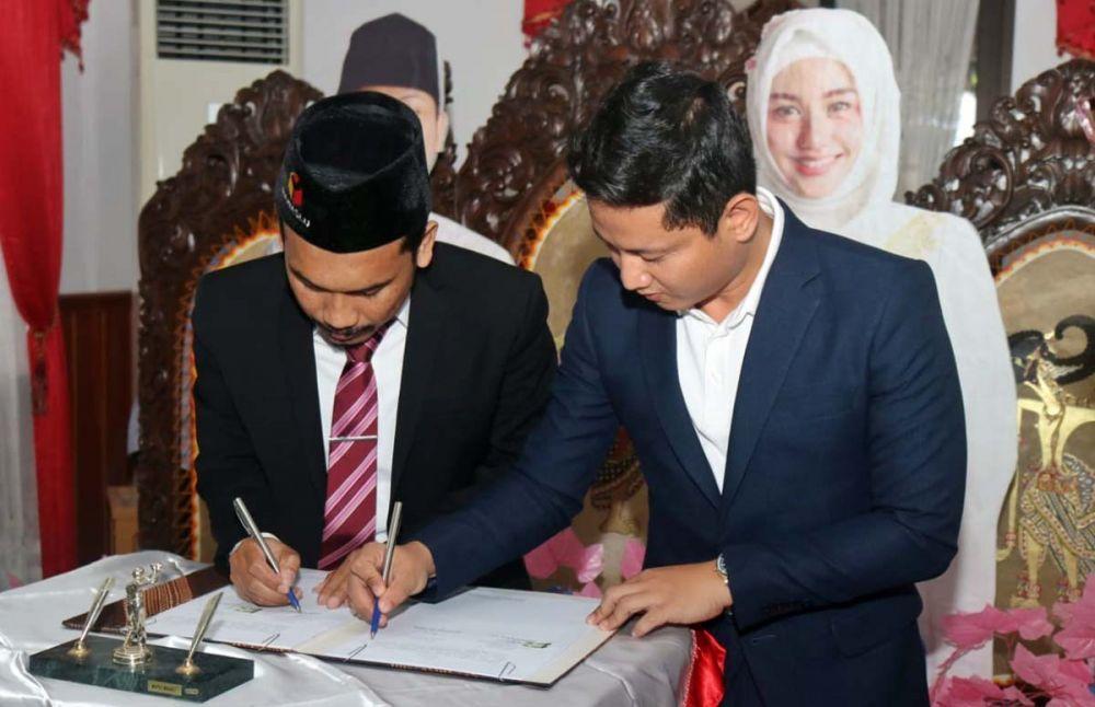 Penandatanganan Naskah Perjanjian Hibah Daerah (NPHD) antara Bupati Nur Arifin dengan KPU dan Bawaslu