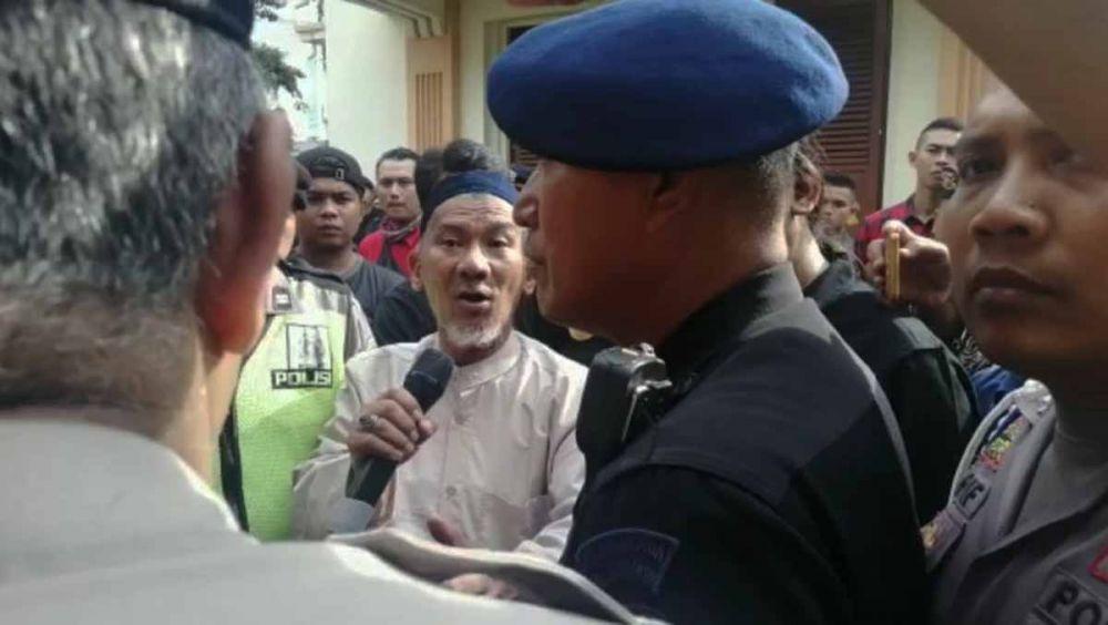 Salim Ahmad, pria yang melontarkan ucapan PKI meminta maaf di depan massa Banser di PN Surabaya, Kamis (13/6/2019)