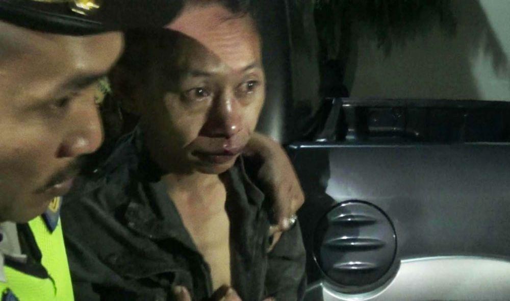 Imam Sopi'i, pelaku penculikan saat diamankan polisi