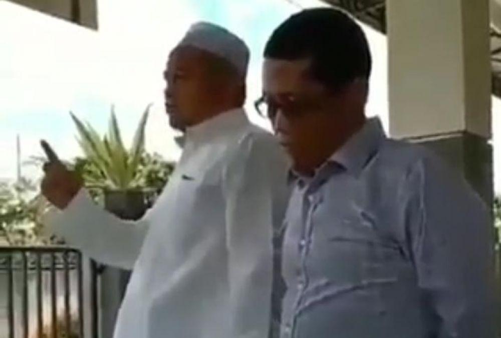 Dua pria dalam video yang beredar