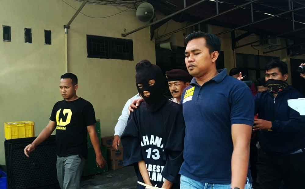 Tersangka saat di Mapolres Malang Kota
